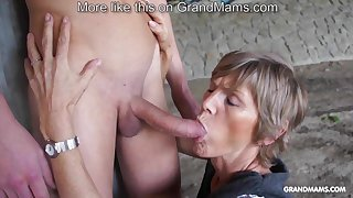 Horny old cougar tapes more her young toyboy with an increment of sucks him off