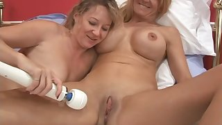 Two older unskilful lesbians are foolishly excited at hand play today!